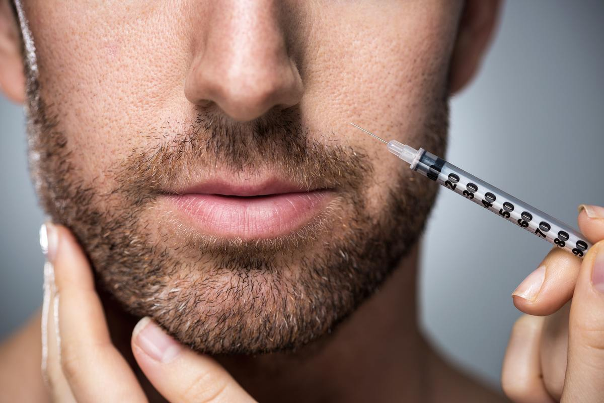 "A man with a needle that is about to administer him with Botox - a practice often called ""Brotox"""